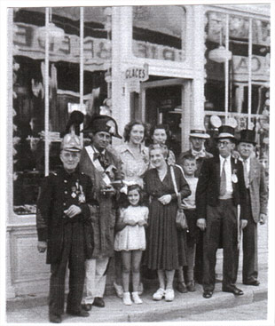 A few members of the Downtown Committee in front of the confectionery store